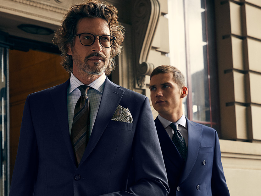 two professional men dressed in luxury suits ready for work in the city