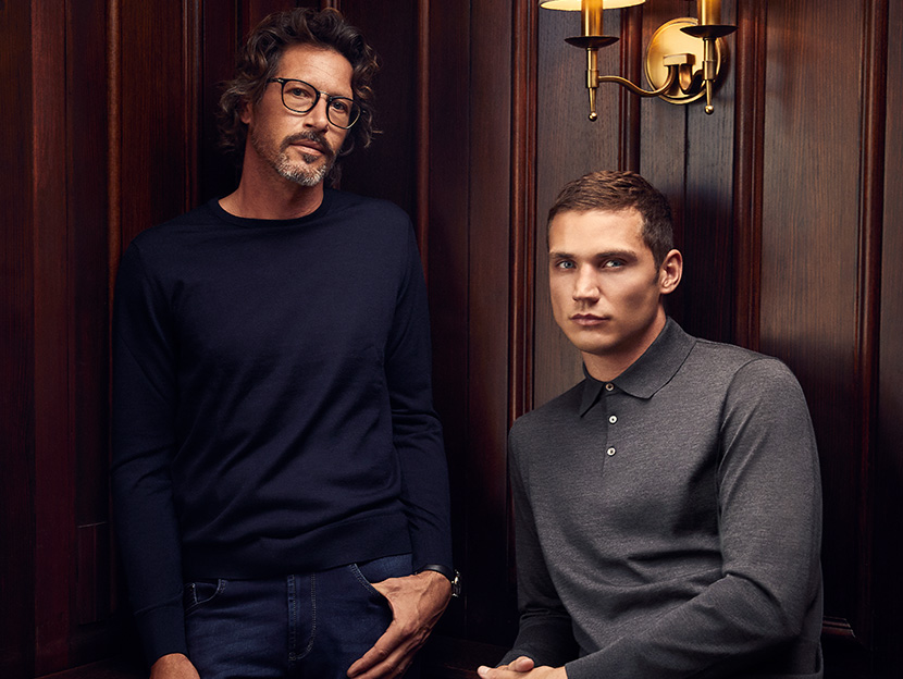 two men casually dressed in luxury knitwear and jeans