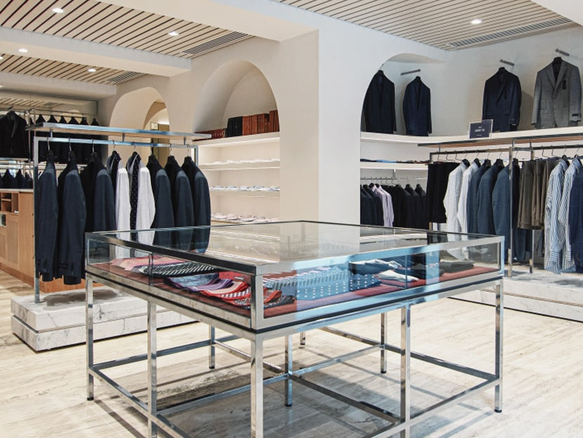 luxury mens clothing store showing suits, sport coat jackets, ties and shirts